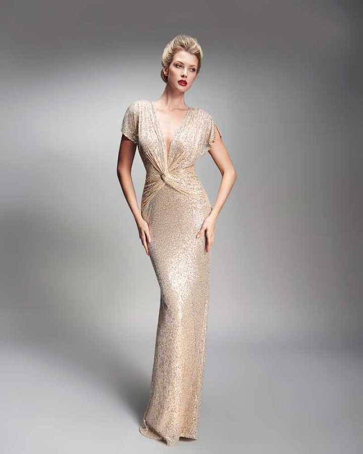 Sequin covered cap sleeve gown with plunging v neck line and knotted detail front