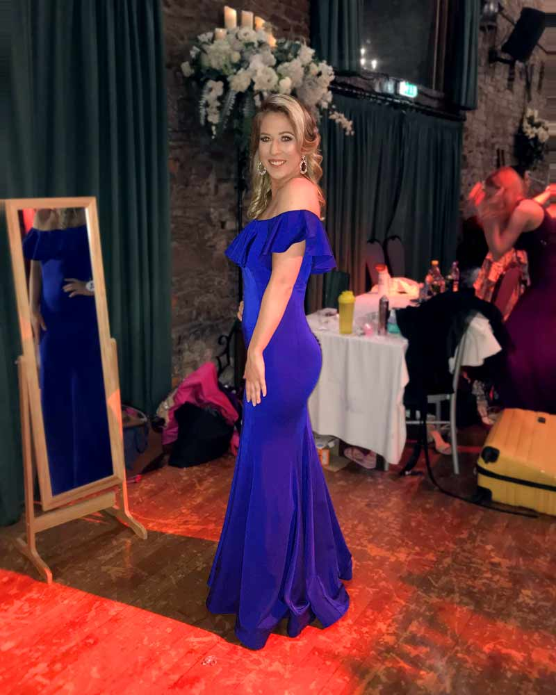 Magdalena wore this blue, figure-hugging, off shoulder ruffle dress for Miss Galaxy Pageant.