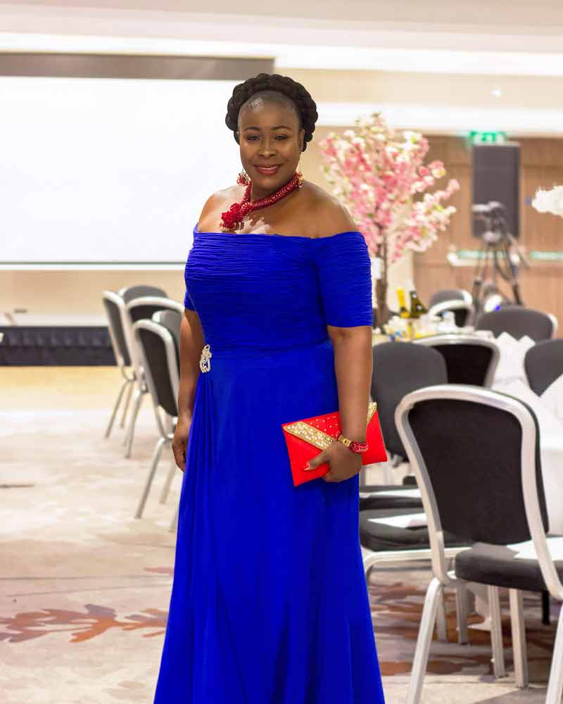 Corniela wearing Royal blue evening gown for her Creating New Beginnings charity event
